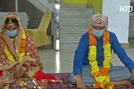Маски й стерильні руки: якими стали індійські весілля