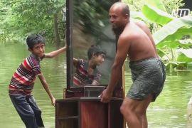 Повінь у передмісті Дакки: люди втікають до притулків