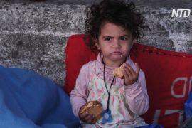 Мігранти на острові Лесбос після пожежі не хочуть селитися в тимчасовому таборі