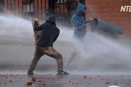 У насильство переросли мирні протести проти податкової реформи в Колумбії
